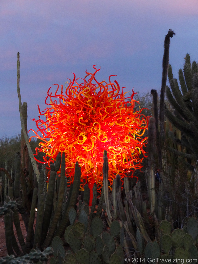 Sun Sculpture by Dale Chihuly at sunset