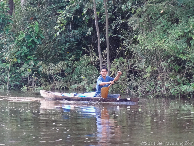 Peruvian canoeing on the Amazon